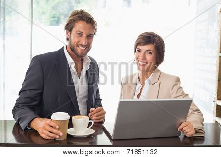 Business colleagues working on their break at the coffee shop
