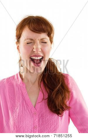 Woman shouting towards the camera on white background