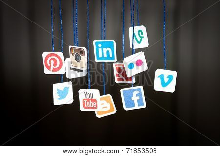 Popular Social Media Website Logo Printed On Paper And Hanging On Strings.