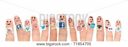 Finger With Popular Social Media Logo Printed On Paper.