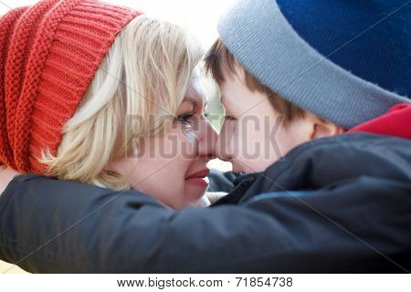 Mother And Son Huddle Together Winter Portrait