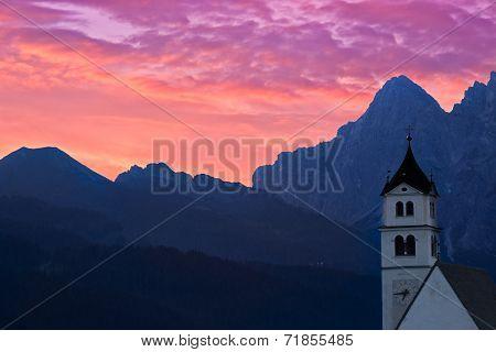 Dolomites Church Colle Santa Lucia at sunrise, Alps, Italy