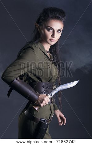 beautiful elf with a knife in his han