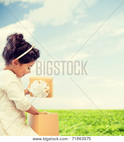 holidays, presents, christmas, x-mas and birthday concept - happy child girl with gift box