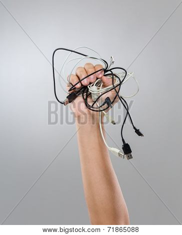 Man hand grasp of cable wire