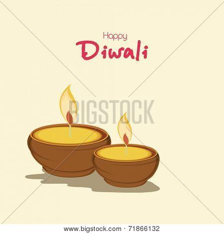 Beautiful illuminated oil lit lamps on beige background for Hindu community festival Happy Diwali celebrations.