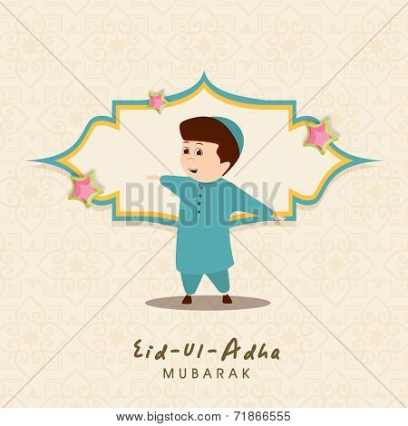 Cute little Muslim boy in traditional clothes for the celebration of Muslim community festival Eid-Ul-Adha celebrations.