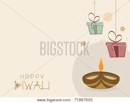 Happy Diwali celebrations greeting card design with illuminated oil lit lamp and gift boxes on beige background.