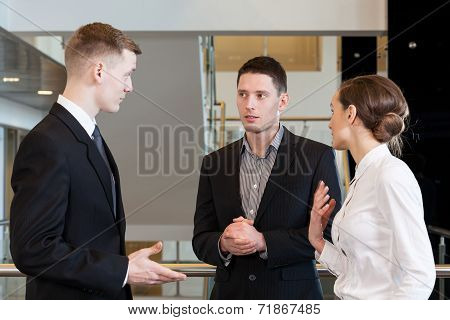 Co-workers Discussing About Job