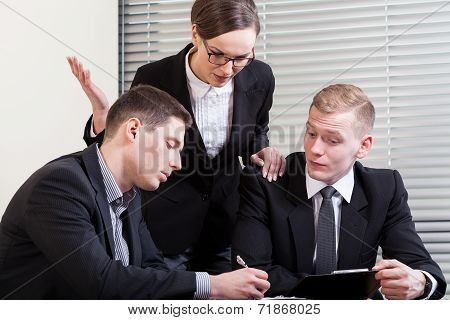 Gesticulating Woman And Their Co-workers