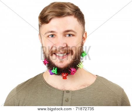 Portrait of handsome man with beard of barrettes isolated on white