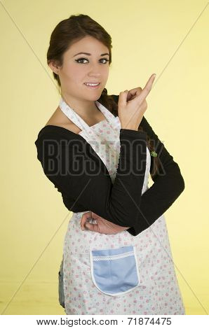 Happy pretty young girl wearing cooking apron