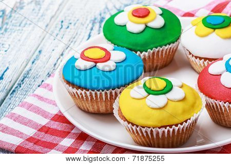 Cupcakes Decorated With Colorful Mastic