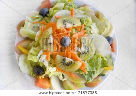 Portugese mixed salad with fruits on a plate
