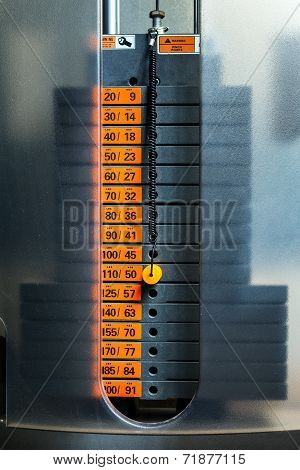Closeup Of Weight Stack With Orange Pin.