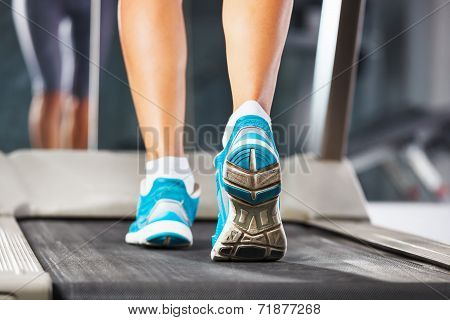 Woman Running On Treadmill In Gym.