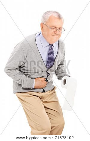 Senior with stomach ache holding toilet paper isolated on white background