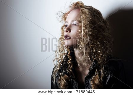 Portrait Of Young Woman With Frizzy Hair