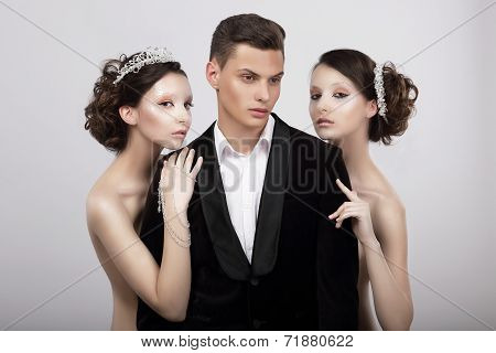 Flirtation. Handsome Man In Cuddle Of Two Voluptuous Women