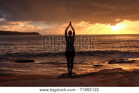 Woman Tadasana  -  Mountain Pose  Yoga By The Sea At Sunrise