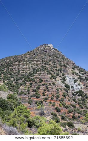 A monastery sits on top of a hill in Cyprus