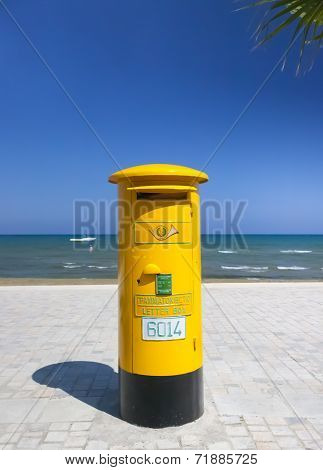Yellow Cyprus Postbox at the beach