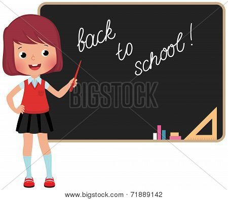 Schoolchild Standing At The Blackboard