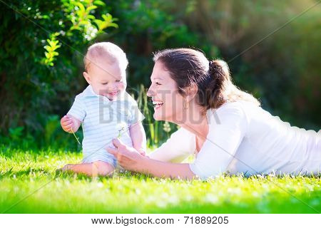 Mother And Baby In The Garden