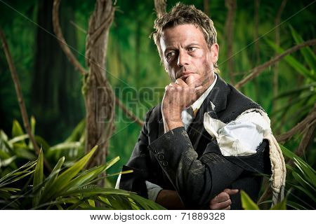 Pensive Businessman In The Jungle Planning Strategies.