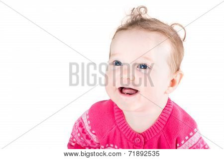 Portrait Of A Sweet Baby Girl With Curly Hair And Blue Eyes Wearing A Pink Sweater With Hearts Patte