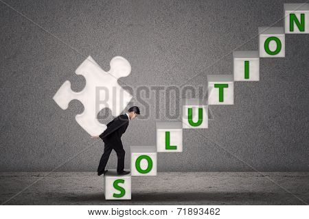 Businessman Bring Puzzle On Solution Stairs