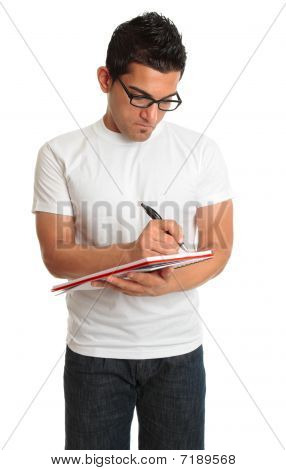 Man Writing In A Book Notepad