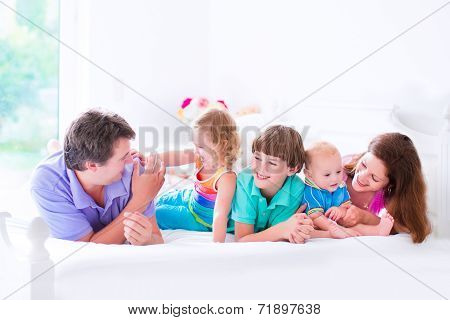 Happy Big Family In A Bed