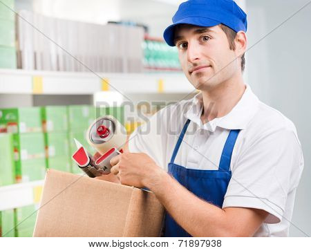 Sales Clerk With Cardboard Box