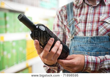 Farmer Buying Wine At Supermarket