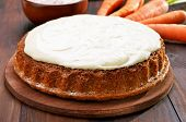 pic of icing  - Carrot cake with icing on wooden table