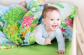 foto of peeking  - Little Happy Laughing Baby Playing Peek - JPG