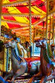 pic of carousel horse  - View of Carousel with horses on a carnival Merry Go Round - JPG