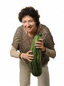foto of phallic  - Woman holding big courgette  - JPG