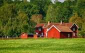 picture of farm landscape  - old red farm set in a rural landscape - JPG