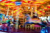 pic of carnival ride  - View of Carousel with horses on a carnival Merry Go Round - JPG
