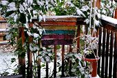picture of planters  - Winter snow on patio deck with hanging planters outdoors - JPG