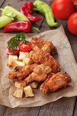 stock photo of southern fried chicken  - Southern fried chicken wings with spicy potato - JPG