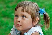 foto of gullible  - Portrait of little girl listening some story - JPG