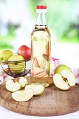 foto of vinegar  - Apple cider vinegar in glass bottle and ripe fresh apples - JPG