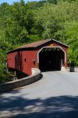 image of covered bridge  - The Colemanville Covered Bridge is a covered bridge that spans Pequea Creek in Lancaster County Pennsylvania - JPG