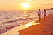 stock photo of romantic love  - happy young romantic couple in love have fun on beautiful beach at beautiful summer day - JPG