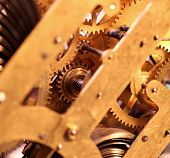 foto of wind up clock  - Close up of an internal clock mechanism - JPG