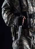 picture of revenge  - Military man with a knife in a hand close up on the black background - JPG