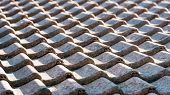 stock photo of roof-light  - Closeup of a tiled roof in early morning light - JPG